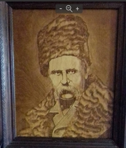 Портрет Т.Г. Шевченко выжженный на дереве.